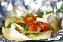 Po zložení z grilu alobal rozbalíme a ryby posypeme nastrúhaným syrom.
